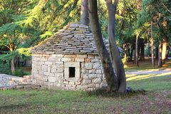 Traditional Istrian Kazun stone hut, Istria Croatia. Small round shelter made of stone for protection of bad weather stock image