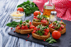 Traditional Italian antipasti bruschetta with vegetable. Traditional Italian antipasti bruschetta with pepper, peas and cheese Royalty Free Stock Image