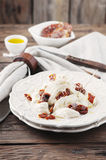 Traditional italian antipasto with burrata and dry tomato Royalty Free Stock Photography