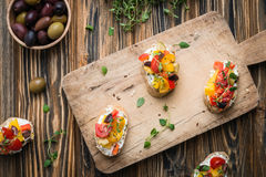 Traditional Italian appetizer, bruschetta with cottage cheese and vegetables Stock Photo