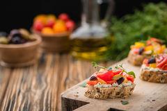 Traditional Italian appetizer, bruschetta with cottage cheese and vegetables Stock Images