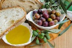 Traditional italian appetizer - fresh homemade bread, extra virg Stock Photos