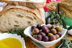 Traditional italian appetizer - fresh homemade bread, extra virg Royalty Free Stock Photos