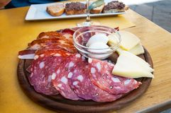 Traditional Italian appetizer meat plate with cheese Stock Images