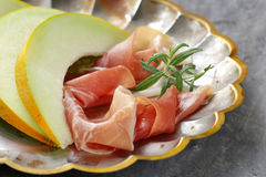 Traditional Italian appetizer parma ham with melon Stock Photos
