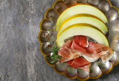 Traditional Italian appetizer parma ham with melon Stock Images