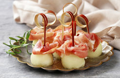 Traditional Italian appetizer parma ham with melon Royalty Free Stock Photo