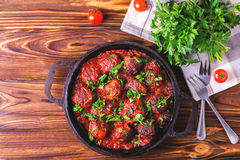 Traditional Italian beef meatballs, tomato sauce and parsley Royalty Free Stock Photography