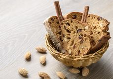 Traditional Italian biscotti Almond Cantuccini in a basket decorated with nuts on wooden table.  Royalty Free Stock Photography