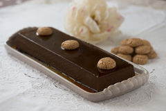 Traditional italian bonet. A traditional italian bonet served with amaretti on an elegant table se Stock Photo