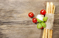 Traditional italian breadsticks on wooden background Stock Photography