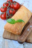 Traditional Italian ciabatta bread with tomato Royalty Free Stock Photography