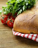 Traditional Italian ciabatta bread with tomatoes Stock Image