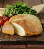 Traditional Italian ciabatta bread with tomatoes Royalty Free Stock Photography