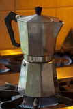 Traditional Italian coffee maker. Famously popular Italian coffee maker on a gas stove Royalty Free Stock Images