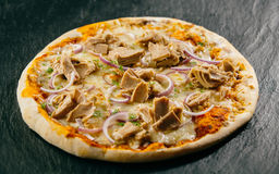 Traditional Italian cuisine - tuna pizza Stock Images