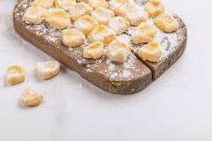 Italian uncooked homemade potato gnocchi with flour. stock images