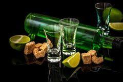 Traditional italian or czech liqueur or bitter with lime slices. Three absinthe glass, cube brown sugar on dark background. free stock photos