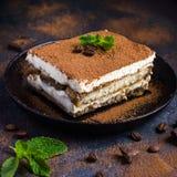 Traditional italian dessert tiramisu on blake plate Royalty Free Stock Photography