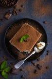 Traditional italian dessert tiramisu on blake plate Stock Photos