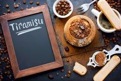 Traditional Italian dessert tiramisu cake in glass on table with Stock Photography
