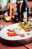 Traditional Italian dish of burrata mozzarella Royalty Free Stock Image
