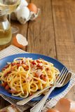 Traditional italian dish spaghetti carbonara. With bacon, egg and cheese stock photos