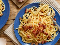 Traditional italian dish spaghetti carbonara. With bacon, egg and cheese stock photography