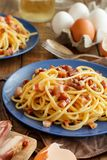 Traditional italian dish spaghetti carbonara. With bacon, egg and cheese royalty free stock images