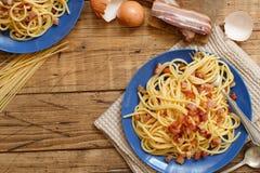 Traditional italian dish spaghetti carbonara. With bacon, egg and cheese royalty free stock photos