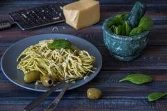 Traditional Italian dish - spaghetti with pesto sauce. Traditional Italian dish of spaghetti with pesto sauce Royalty Free Stock Photo