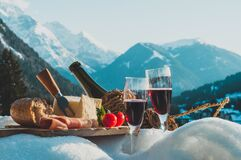 Free Traditional Italian Food And Drink Outdoor In Sunny Winter Day. Romantic Alpine Picnic In Dolomites With Mountains Background Royalty Free Stock Image - 170114456