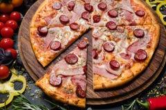 Italian food cuisine pizza slice ham prosciutto. Traditional italian food cuisine. delicious pizza slice ham prosciutto and pepperoni royalty free stock photos