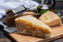 Traditional italian food - 36 months aged in caves Italian parmesan hard cheese from Parmigiano-Reggiano, Italy stock photo
