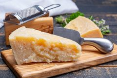 Traditional italian food - 36 months aged in caves Italian parmesan hard cheese from Parmigiano-Reggiano, Italy stock photography