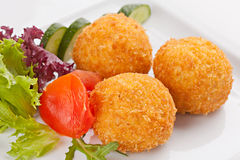 Traditional Italian food of rice with fillings. Covered with bread crumbs, and fried Stock Photos
