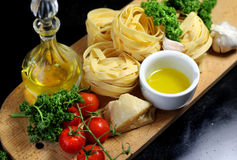 Traditional Italian food tagliatelle with ingredients Stock Image