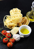 Traditional Italian food tagliatelle with ingredients Stock Photography