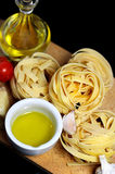Traditional Italian food tagliatelle with ingredients Stock Images