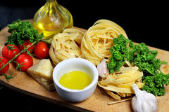 Traditional Italian food tagliatelle with ingredients Stock Photos