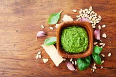 Traditional italian fresh pesto sauce with raw ingredients top view. Healthy and organic food. Traditional italian fresh pesto sauce with raw ingredients from royalty free stock images