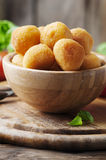 Traditional italian fried balls of mozzarella. Selective focus Royalty Free Stock Images
