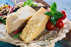 Traditional Italian hard cheese Parmesan and Grana Padano with c Stock Photography