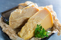 Traditional Italian hard cheese Parmesan and Grana Padano with g Royalty Free Stock Photos