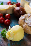 Traditional Italian hard cheese Provolone of Caciocavallo, white Stock Image