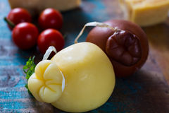Traditional Italian hard cheese Provolone of Caciocavallo, white Royalty Free Stock Photo