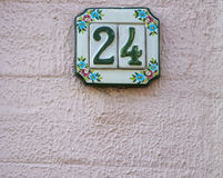Traditional Italian home sign board painted on ceramic tile. Placed on the wall. Number twenty-four 24 Stock Image