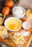 Traditional italian homemade pasta with ingredients. Vertical Stock Photos