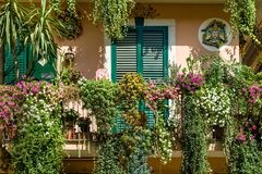 Traditional Italian house decorated by flowers Royalty Free Stock Photos