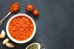 Traditional Italian Marinara or Pomodoro Tomato Sauce. Homemade traditional Italian marinara or pomodoro tomato sauce made of fresh tomato, garlic, dried oregano Royalty Free Stock Image